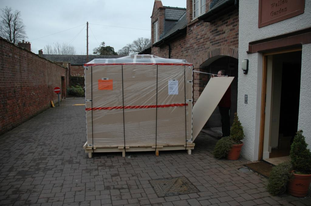 The new Deltec tank arrives on the purpose made pallet direct from Germany. The tank is crated already on its stand so that it can be positioned as a single unit.